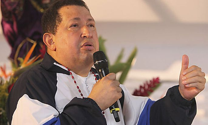 Venezuelan President Hugo Chavez attends a mass to pray for his health in his hometown of Barinas