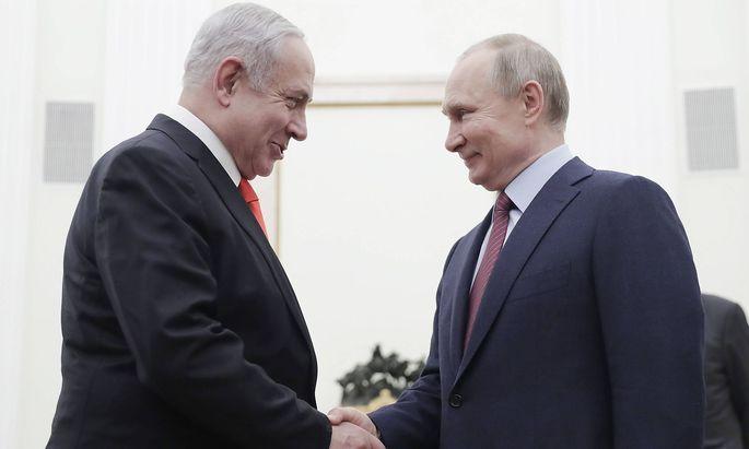 MOSCOW, RUSSIA - JANUARY 30, 2020: Israel s Prime Minister Benjamin Netanyahu (L) and Russia s President Vladimir Putin