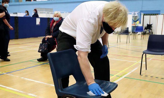 Britain's Prime Minister Boris Johnson visits a vaccination centre at Cwmbran Stadium