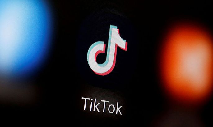FILE PHOTO: A TikTok logo is displayed on a smartphone