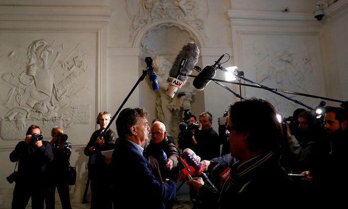 Head of Greens Kogler arrives for a meeting in Vienna