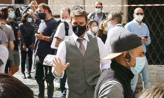 Italy: Tom Cruise on the set of Mission Impossible Tom Cruise greets fans during a break in filming of Mission Impossibl