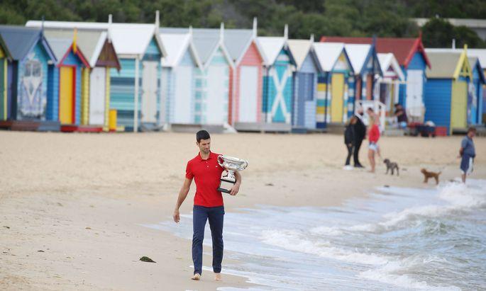 Novak Djokovic, SRB, presenting his trophy after 2021 Australian Open final in Melbourne on Brighton beach, 22/02/2021;