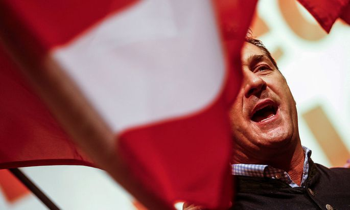 Leader of the Austrian Freedom party Heinz-Christian Strache waves an Austrian flag during a May Day event in Linz