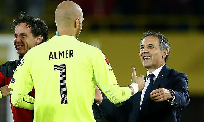 Austria's goalkeeper Almer and Austria's coach Koller celebrate after Austria won their Euro 2016 Group G qualification soccer match against Moldova in Vienna