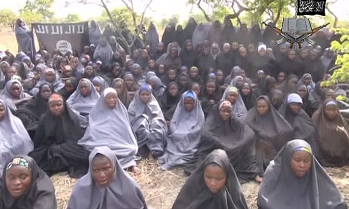 Kidnapped schoolgirls are seen at an unknown location in this still image taken from an undated video released by Boko Haram