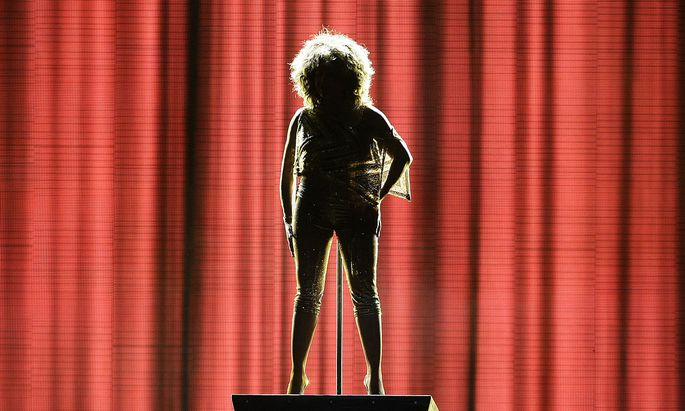 Tina Turner is silhouetted during her concert in London