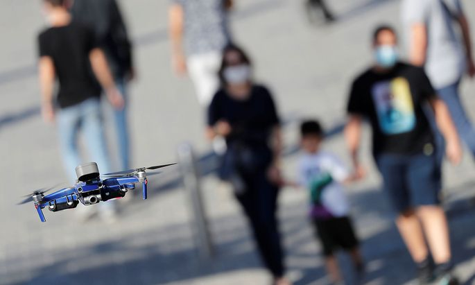 Police drone fitted with a megaphone speaker flies over the Taksim Square in Istanbul