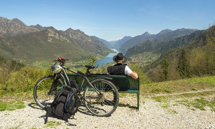 Italy Lombardy Senior hiker looking over Idro lake Adamello Alps Parco Naturale Adamello Brenta