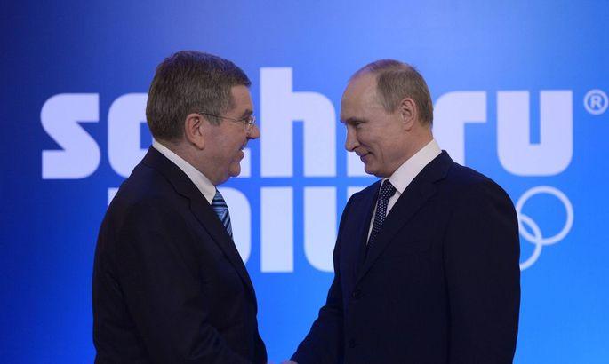 ITAR TASS SOCHI KRASNODAR TERRITORY FEBRUARY 4 2014 IOC chief Thomas Bach L and Russia s pres