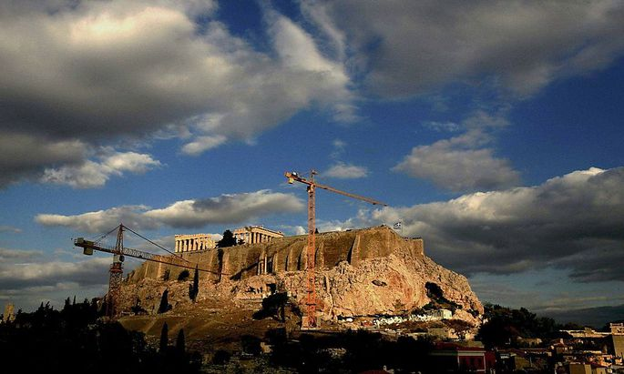File picture of cranes at foothills of Acropolis during transfer operation of artefacts from Acropolis to new location some 400 meters away in Athens