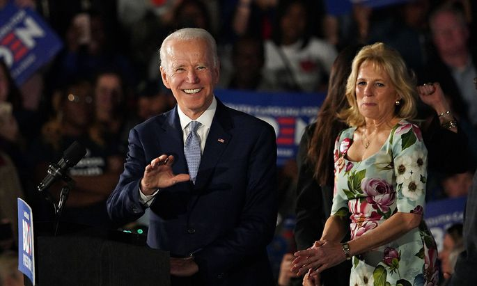 Democratic presidential candidate Vice President Joe Biden and his wife Dr. Jill Biden smile as supporters greet them a