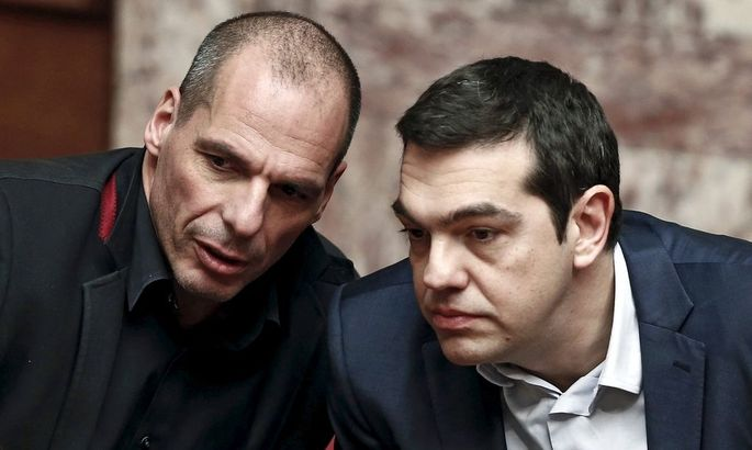 File photo of Greek PM Tsipras and Finance Minister Varoufakis talking during the first round of a presidential vote at the Greek parliament in Athens
