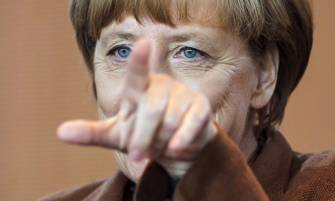 German Chancellor Merkel arrives for the weekly cabinet meeting at the chancellery in Berlin