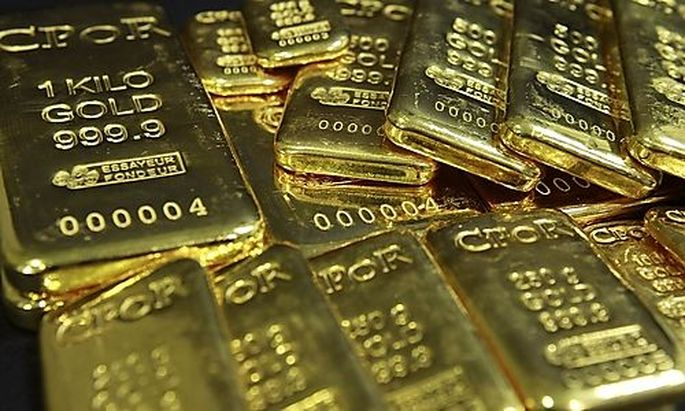 Gold bars weighing between 50 grams and 1 kilo are displayed in an office of French gold supplier CPo