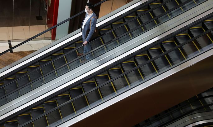 A man wearing a mask takes the escalator, amid the coronavirus disease (COVID-19) outbreak in Singapore