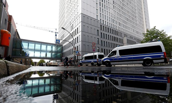 FILE PHOTO: A view shows police vehicles outside the Charite Mitte Hospital Complex in Berlin