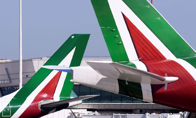 FILE PHOTO: Alitalia airplanes are pictured at Leonardo da Vinci-Fiumicino Airport in Rome