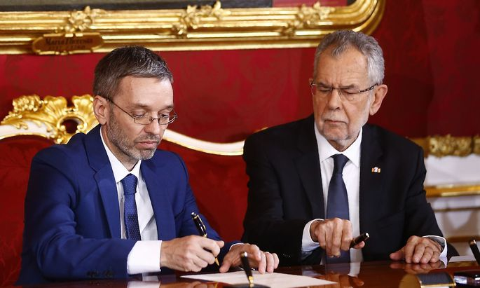 Austrian president van der Bellen and new interior minister Kickl shake hands during the swearing-in ceremony of the new government in Vienna, December 18, 2017