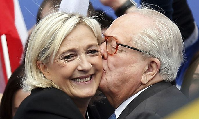 File photo of Jean-Marie Le Pen, France's National Front political party founder, and his daughter Marine Le Pen, National Front political party leader, after her speech at their traditional rally in Paris