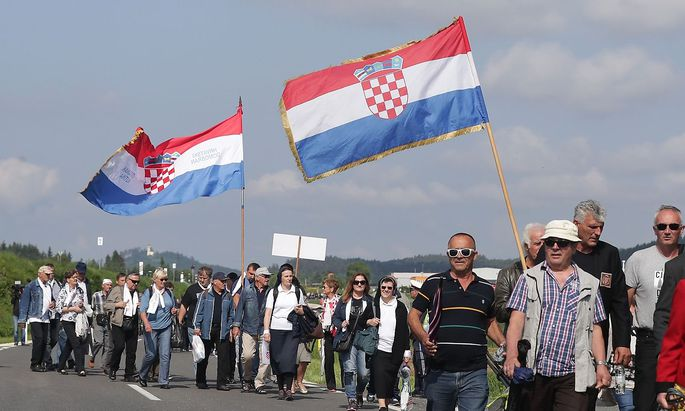 Participants arrive at a Catholic ceremony commemorating the turning away from Austria of pro-Nazi Croatians at the end of World War Two in Bleiburg
