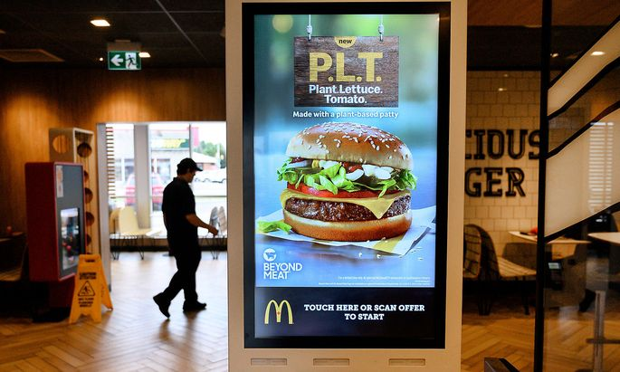 FILE PHOTO: A sign promoting McDonald's 'PLT' burger with a Beyond Meat plant-based patty at one of 28 test restaurant locations in London, Ontario