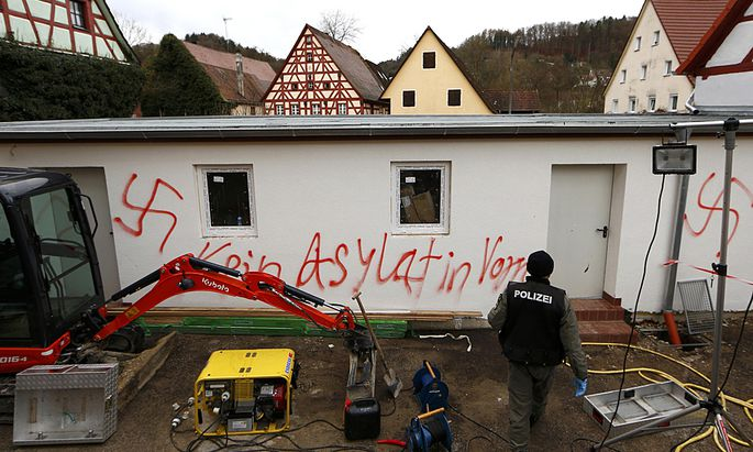 Swastikas are painted on a wall in Vorra near Nueremberg