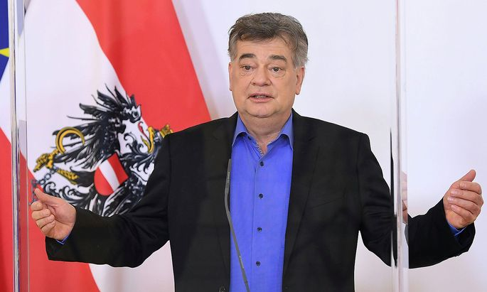 Austrian Vice-Chancellor Kogler attends a news conference in Vienna