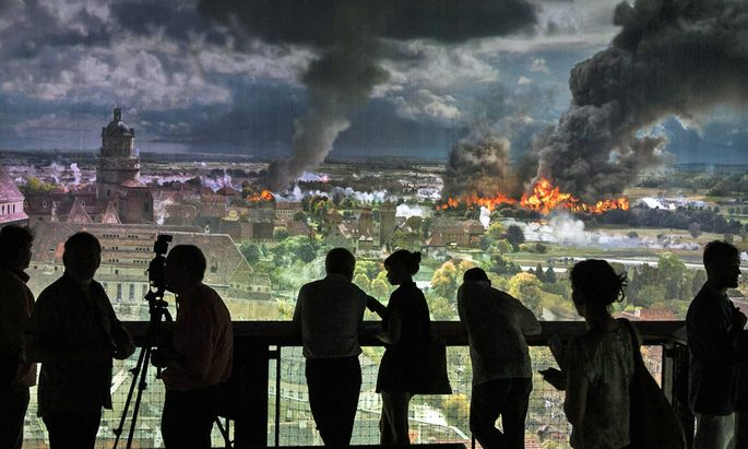 People look at a section of the a 360 degree panoramic picture of the historic Battle of the Nations in Leipzig