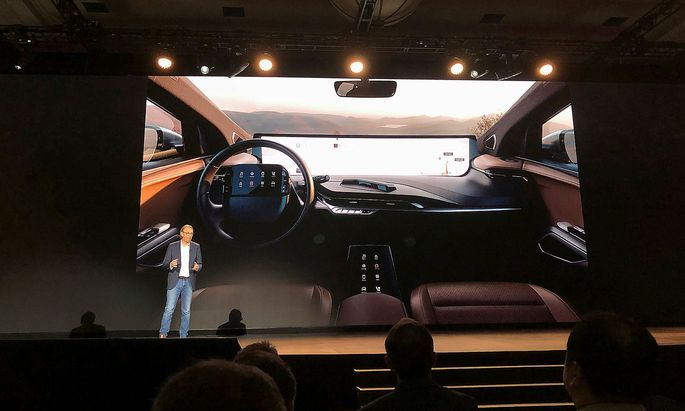 Benoit Jacob, head of design for Byton, speaks about the 48-inch screen inside the company's electric vehicle, set for production later in 2019, during the 2019 CES in Las Vegas