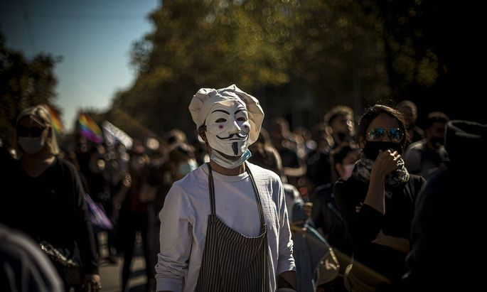 October 16, 2020, Barcelona, Catalonia, Spain: A cook wearing a Guy Fawkes mask takes part in a protest against harsher