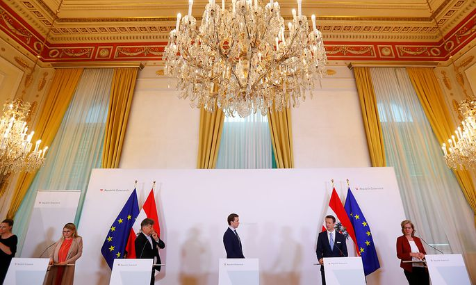 Austrian Chancellor Sebastian Kurz and Vice Chancellor Werner Kogler attend a news conference, following an outbreak of the coronavirus disease (COVID-19), in Vienna