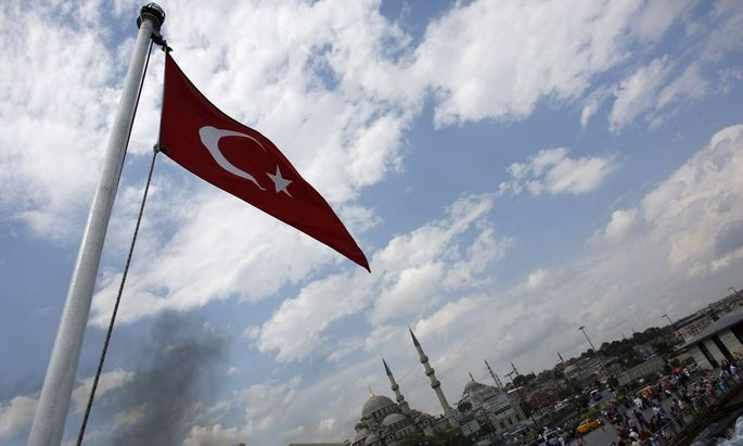 A Turkish flag flies on a passenger ferry in Istanbul