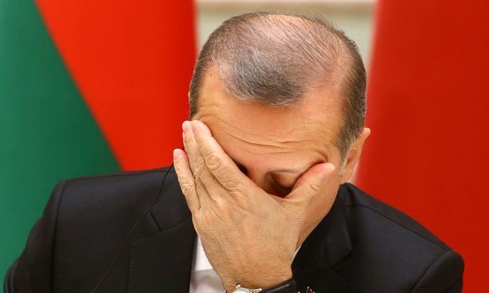 Turkish President Tayyip Erdogan reacts during signing ceremony with Belarussian President Lukashenko in Minsk