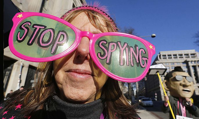 Founder of Code Pink protests against U.S. President Barack Obama and the NSA before arrival at Department of Justice in Washington
