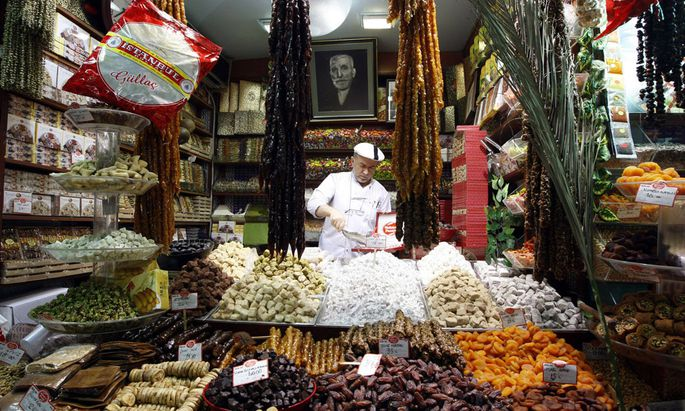 A Turkish vendor sells dates and dried fruits at the Egyptian Bazaar during preparations for the upcoming holy month of Ramadan, in Istanbul