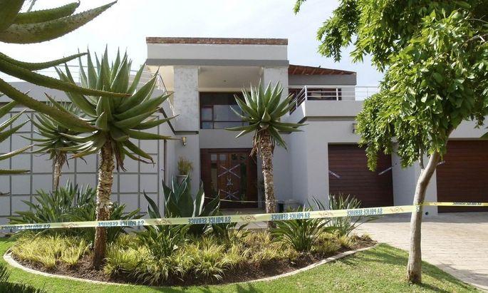 Police crime scene tape marks off the Pretoria home of South African 'Blade Runner' Oscar Pistorius
