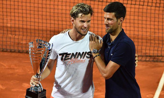 Adria Tour - medal ceremony Dominic Thiem (L) of Austria and Novak Djokovic during medal ceremony of the Adria Tour ten
