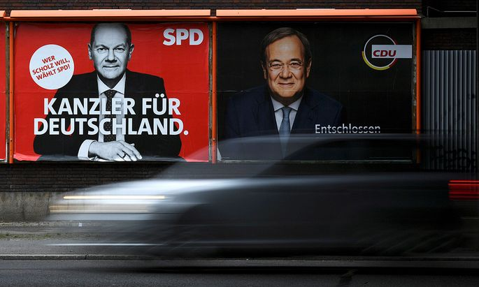 An election campaign billboard, featuring SPD´s Olaf Scholz and CDU´s Armin Laschet is pictured in Berlin