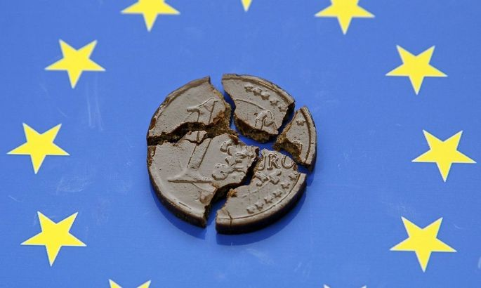 Photo illustration of chocolate one Euro coin on Euro flag