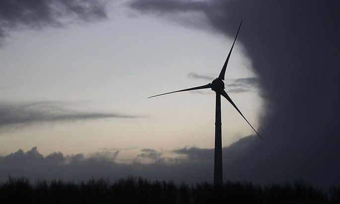 A wind turbine is seen near the North Sea near the town of Emden
