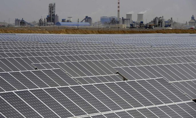 File photo of a solar power plant near a thermal power plant in Aksu