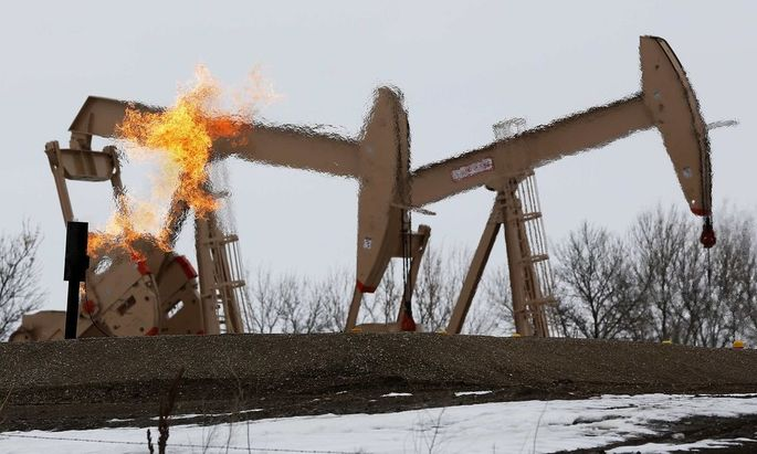 File photo of natural gas flares are seen at an oil pump site outside of Williston, North Dakota