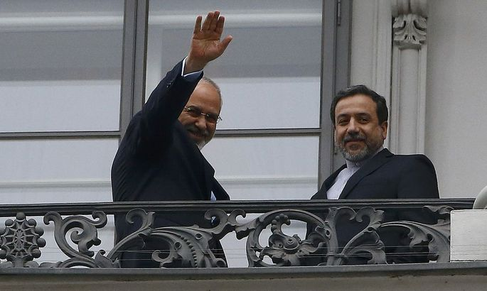 Iranian Foreign Minister Zarif and Araghchi, Iran's chief nuclear negotiator, stand on the balcony of Palais Coburg in Vienna