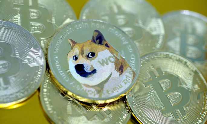 In this photo illustration, visual representations of digital cryptocurrencies, Dogecoin and Bitcoin, are arranged on J