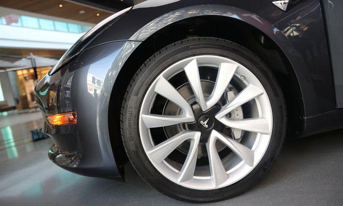 A Tesla Model 3 is seen in a showroom in Los Angeles