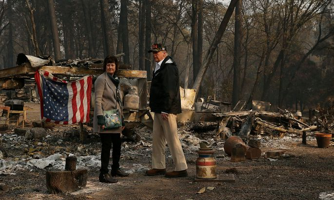 U.S. President Donald Trump visits the Skyway Villa Mobile Home and RV Park, a neighborhood destroyed by the camp fire with Mayor Jody Jones in Paradise