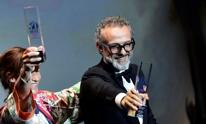 Massimo Bottura, the chef patron of Osteria Francescana restaurant in Italy, receives the award for Best Restaurant during the World's 50 Best Restaurants Awards at the Palacio Euskalduna in Bilbao