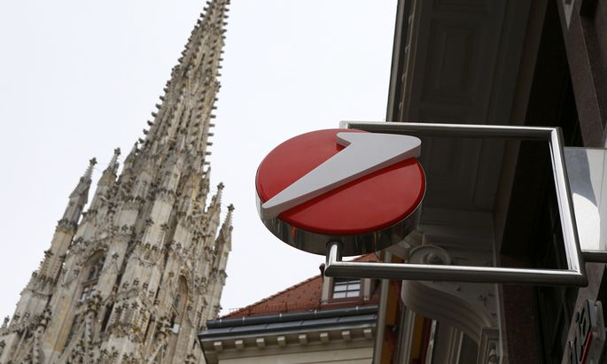 The logo of UniCredit, Italy´s biggest bank by assets, is pictured next to a spire St. Stephen´s cathedral at a UniCredit unit Bank Austria branch office in Vienna