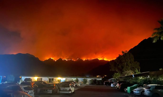 MUGLA PROVINCE, TURKEY - JULY 30, 2021: A wildfire approaches the village of Orhaniye, 28.6km west of the Aegean Sea re